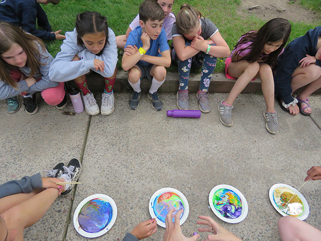 campers working on craft project with paint