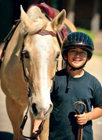 boy with horse at camp