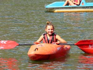 kayaking in the lake at camp