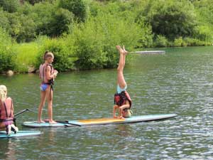 paddleboard on the lake at camp