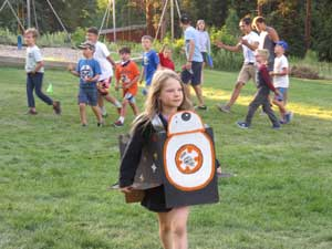 girl wearing BB8 costume at camp