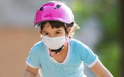 girl riding bike at ymca camp