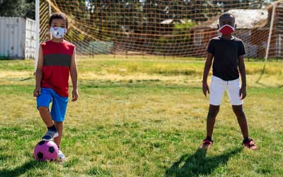 boys wearing masks at ymca soccer camp