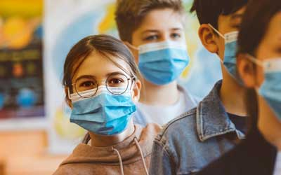 girl wearing mask at after school care