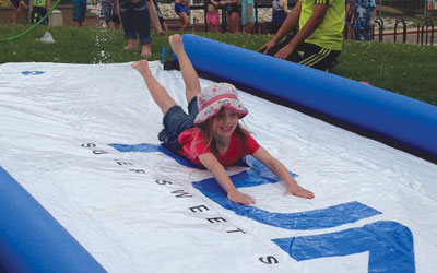 girl on slip-n-slide at y camp
