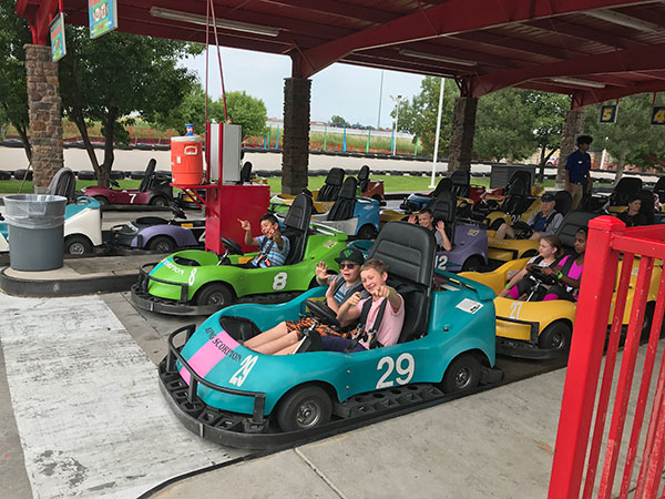 YMCA teen campers head out on go carts